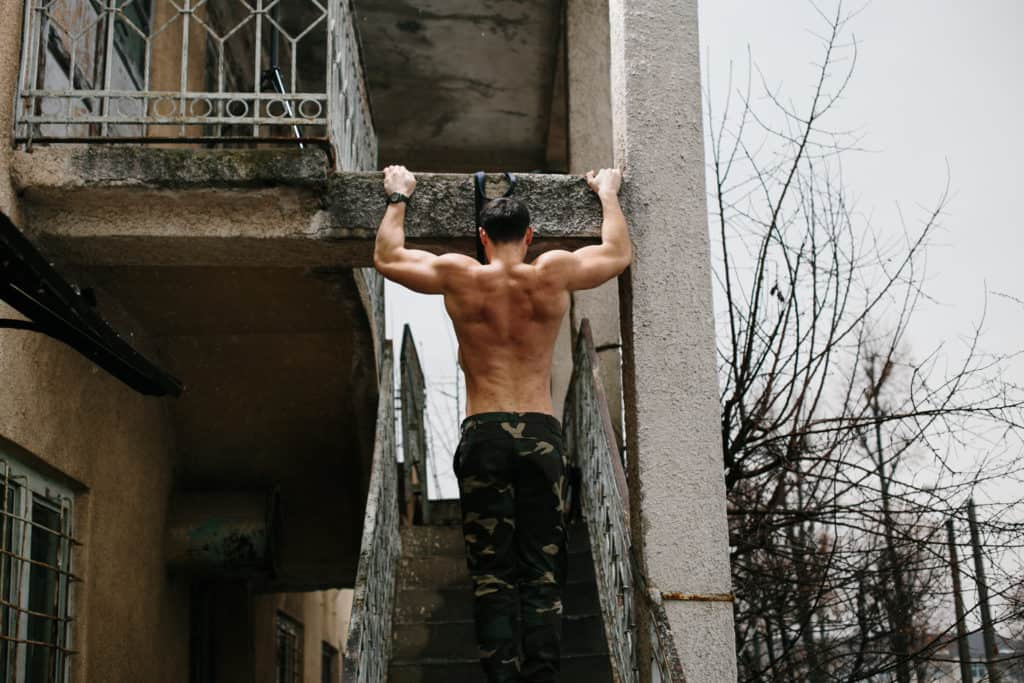 pullups at a concrete beam for forearms and fingers
